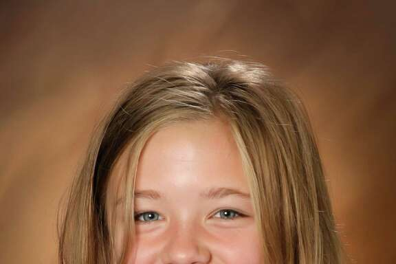 Sydnee Ruth Neiman, 9, dropped her piggy bank in a credit union parking lot in West Richland, Wash., on Dec. 8, 2011. Her mother thought she was already in her seat in the Cadillac Escalade and backed over her.