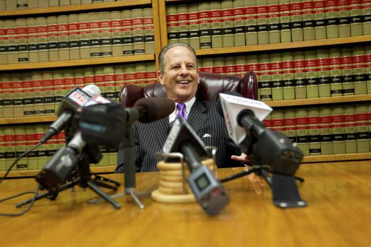 Attorney Brian Wice talks about news the decision by an appeals court to overturn the conviction of former U.S. House Majority Leader Tom DeLay at his office Thursday, Sept. 19, 2013, in Houston.