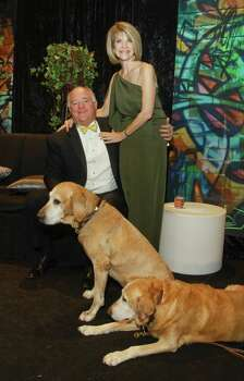 Kim and Dan Tutcher with Sullivan and Riley at the CAP gala in 2012. Pets are welcome at the event. Photo: Gary Fountain, Freelance / Copyright 2012 Gary Fountain.