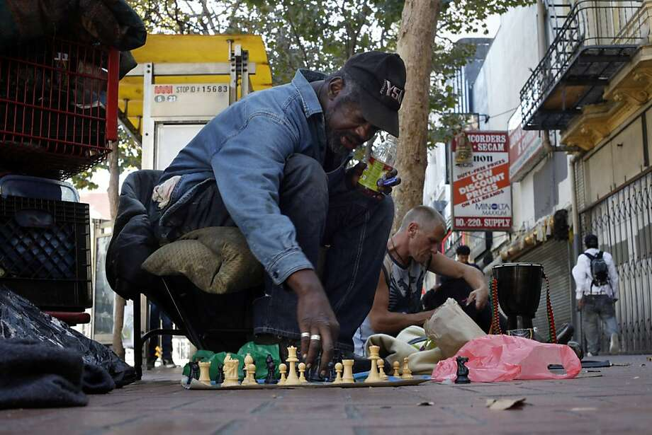 Marvin Boykins, 57, plays chess as he sits between 5th and 6th and Market Street , Monday September 16, 2013, in San Francisco, Calif. Marvin known also as Grand Master learned to play chess when he was 7 years old. Photo: Lacy Atkins, The Chronicle