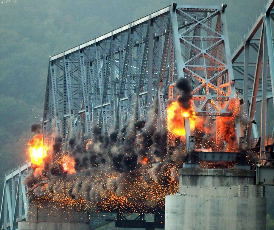 Boom goes the dynamite: The last section of the old U.S. 421 Madison-Milton Bridge was brought down with explosives at around 8:30 a.m. Thursday, Sept. 19, 2013 in Madison, Ind. Photo: Ken Ritchie, Associated Press