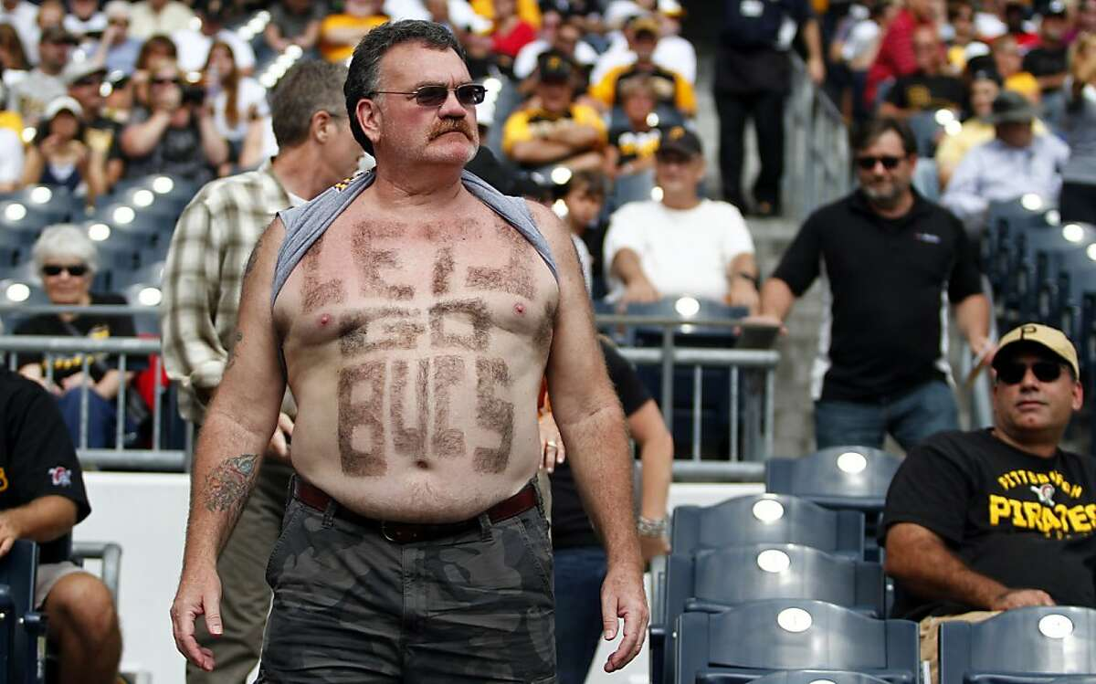 Stand proud, hairy super fan: Apparently his beer belly isn't big enough to shave 'Pirates' into.