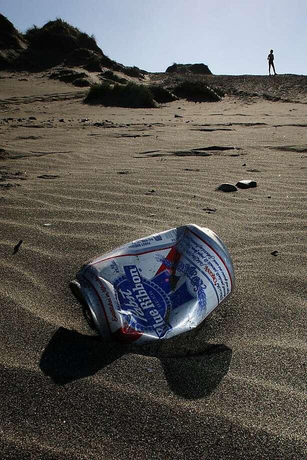 On Saturday, volunteers will hit waterways and coastal spots, like Ocean Beach, to pick up the trash left behind. Photo: Liz Hafalia, The Chronicle