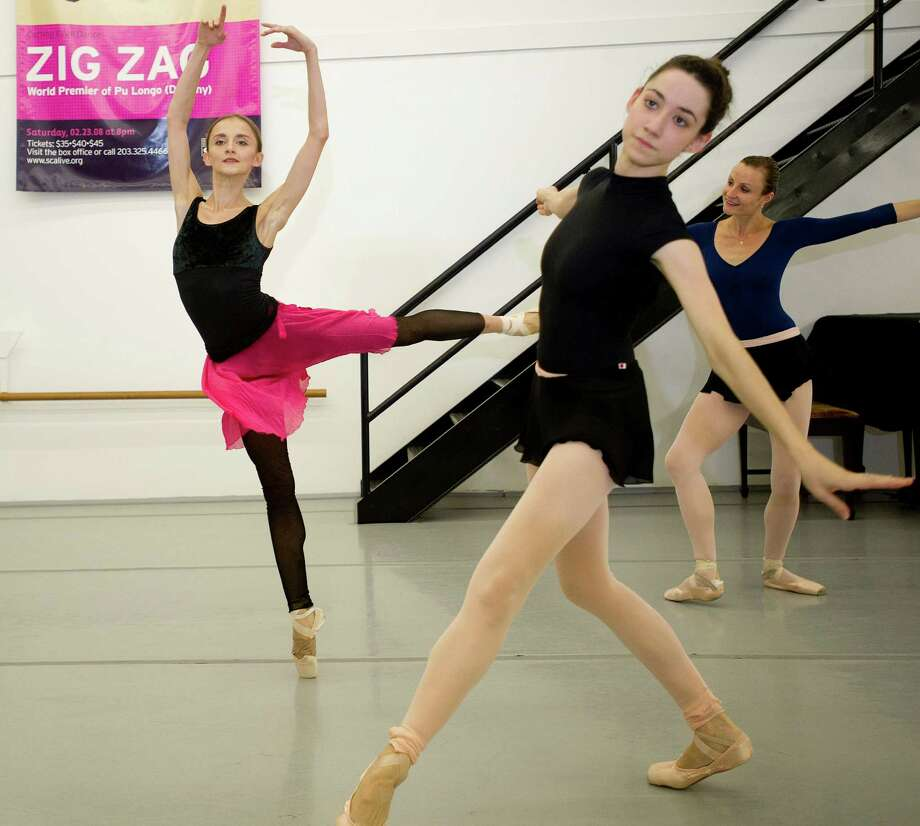 Principal dancer Oksana Maslova of Connecticut Ballet, left, performs a preview of the upcoming ballet, Cinderella, on Thursday, Sept. 19, 2013. The ballet will be performed in Stamford October 12, 2013. Photo: Lindsay Perry / Stamford Advocate
