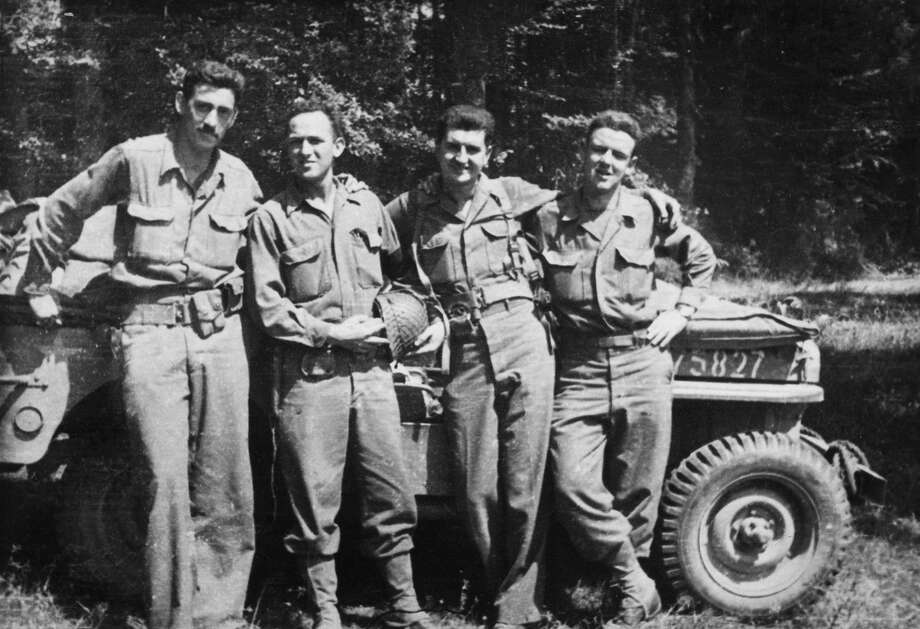 "Author J.D. Salinger, left, is shown with his fellow counterintelligence officers following the invasion of Normandy in the documentary ""Salinger."" Photo: HOEP / The Weinstein Company"