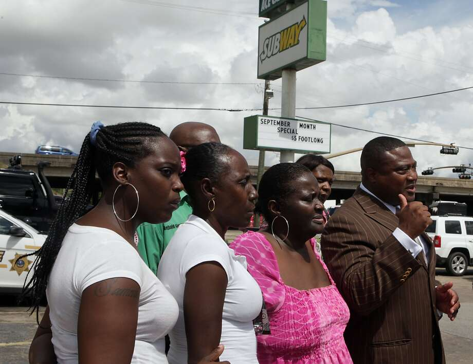 Quanell X right, speaks during a press conference in front of the Subway sandwich shop at Loop 610 and MLK Blvd. where customer Christopher McGrew was killed during a robbery Tuesday at the shop, Thursday, Sept. 19, 2013, in Houston. ( James Nielsen / Houston Chronicle ) Photo: James Nielsen