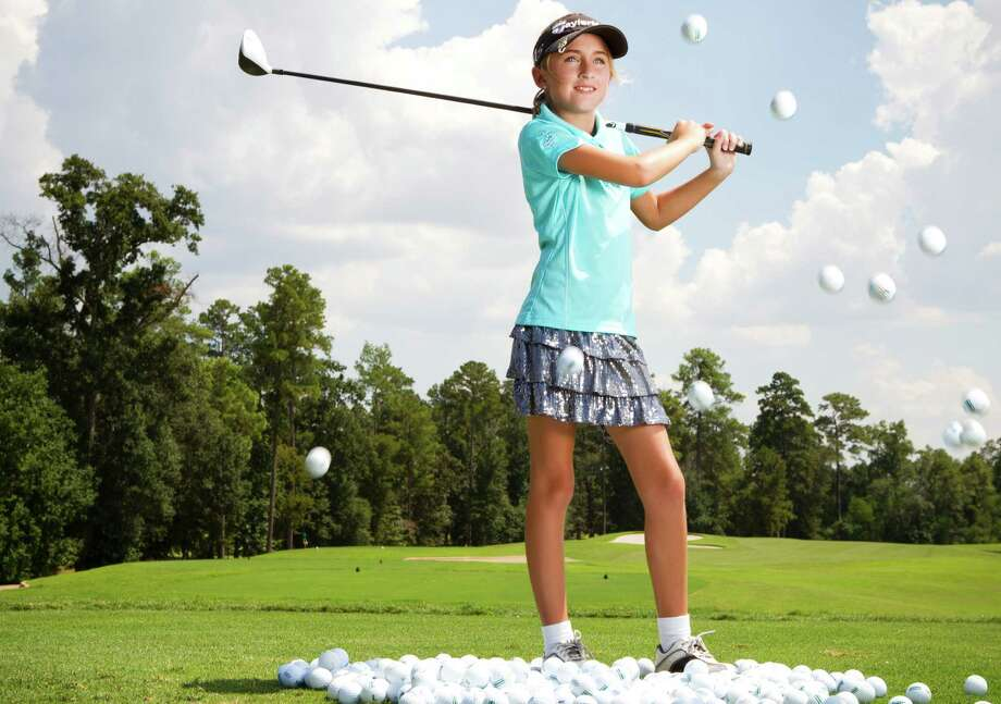 "Sky Sudberry is ""99 percent sure"" she wants to be a professional golfer. Her dad, Bob, says he's glad the film isn't about winning so much as what it takes to win. Photo: Brett Coomer, Staff / © 2013 Houston Chronicle"