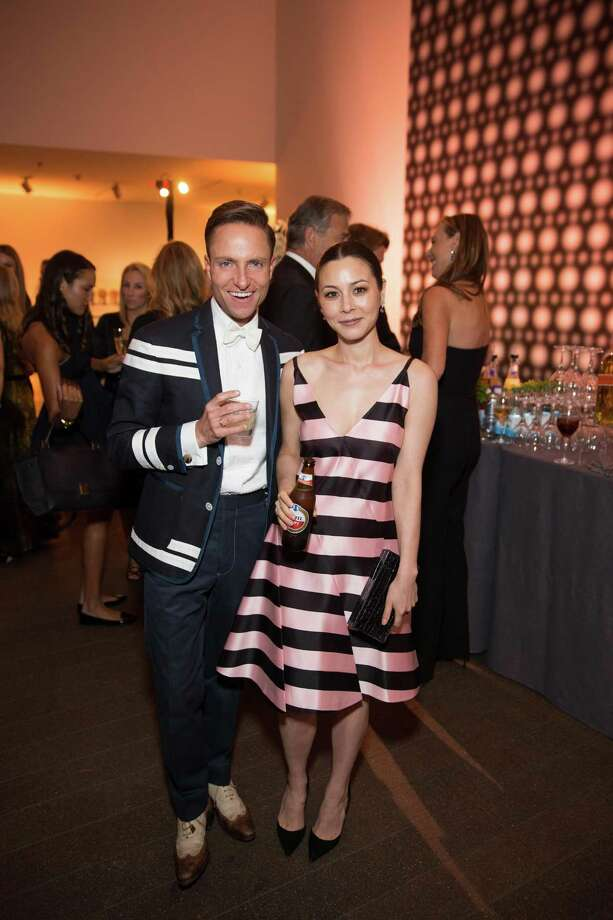 """China Chow poses with Ken Fulk at the opening party for the """"The Art of Bulgari: La Dolce Vita & Beyond, 1950-1990"""" exhibit at the de Young Museum on September 18, 2013. Photo: Drew Altizer Photography / ©Drew Altizer"""
