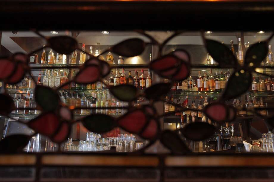 Leaded glass panels divide dining spaces from the bar. Photo: Carlos Avila Gonzalez, The Chronicle