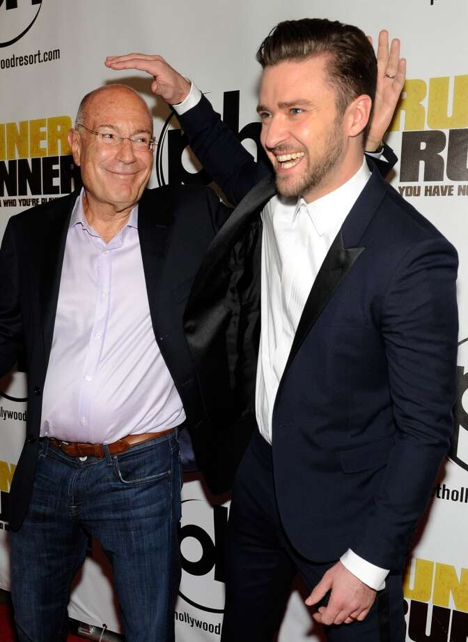 "Regency Chairman Arnon Milchan (L) and singer/actor Justin Timberlake arrive at the world premiere of Twentieth Century Fox and New Regency's film ""Runner Runner"" at Planet Hollywood Resort & Casino on September 18, 2013 in Las Vegas, Nevada.  (Photo by David Becker/Getty Images) Photo: David Becker, Getty Images"