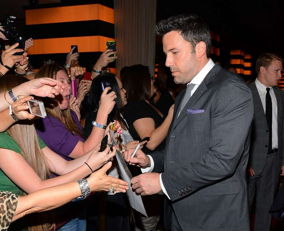 "Actor/director Ben Affleck signs autographs for fans as he arrives at the world premiere of Twentieth Century Fox and New Regency's film ""Runner Runner"" at Planet Hollywood Resort & Casino on September 18, 2013 in Las Vegas, Nevada.  (Photo by Ethan Miller/Getty Images) Photo: Ethan Miller, Getty Images"