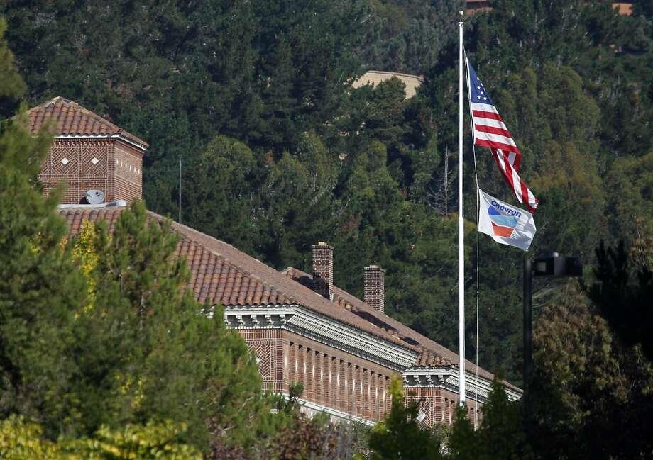 A Chevron flag flies on a flag pole near the entrance to the Chevron Refinery in Richmond, Calif. on Thursday, Aug. 9, 2012. Photo: Paul Chinn, The Chronicle