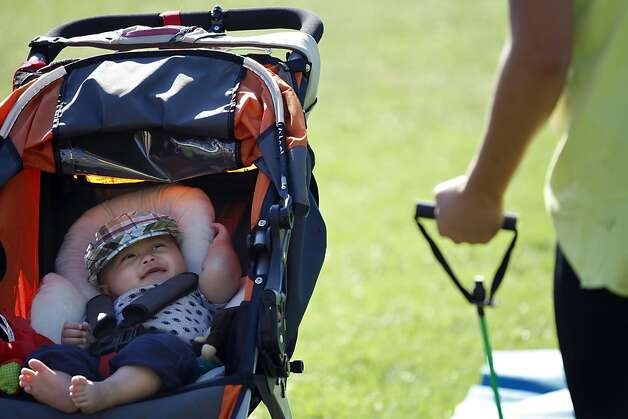 Jennifer Benito-Kowalski, right, attends a Stroller Striders exercise class with her son Kyle in San Carlos, Calif., Wednesday, Sept. 18, 2013. Photo: Nicole Fruge, The Chronicle