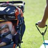 Jennifer Benito-Kowalski, right, attends a Stroller Striders exercise class with her son Kyle in San Carlos, Calif., Wednesday, Sept. 18, 2013.