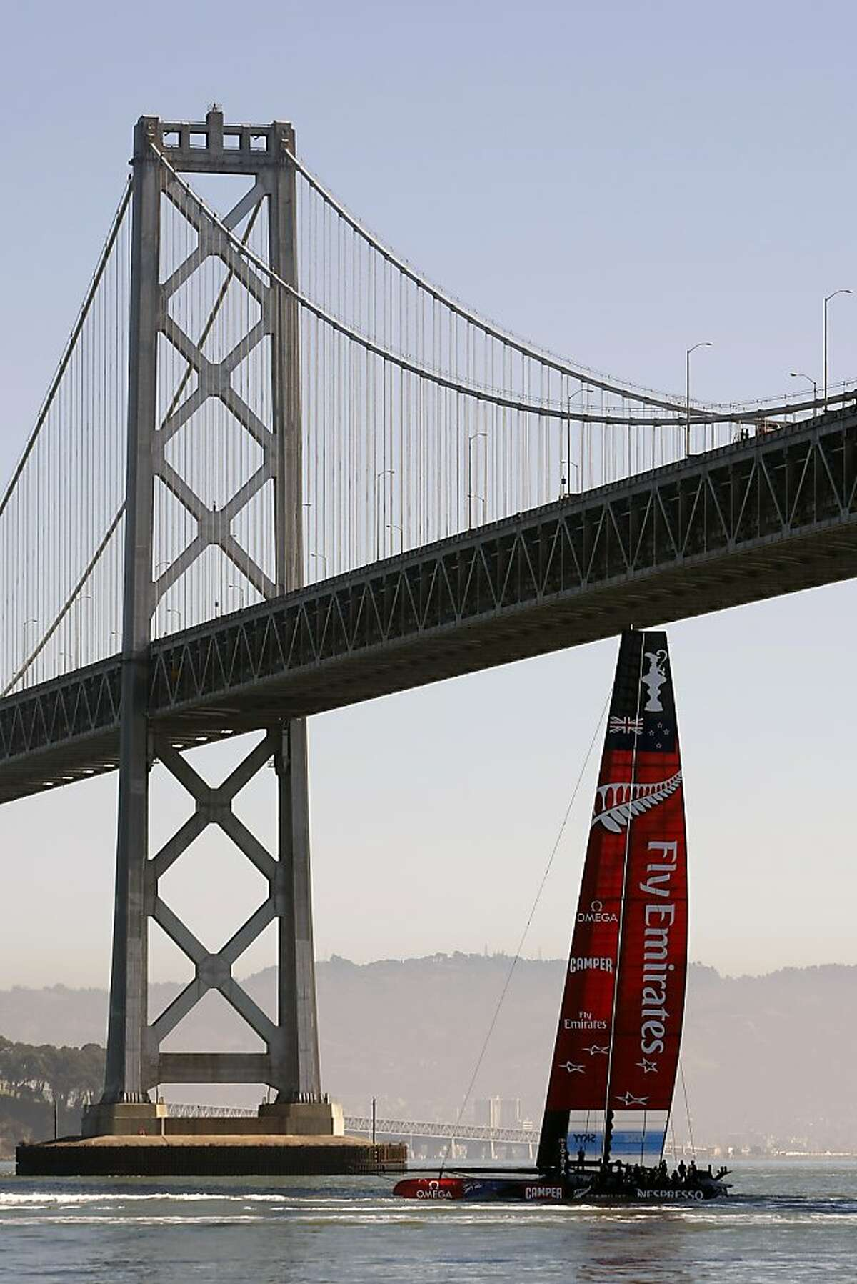 Emirates Team New Zealand sails it's AC72 under the Bay Bridge as it heads out for the days America's Cup Final races in San Francisco, California Thursday, September 19, 2013.