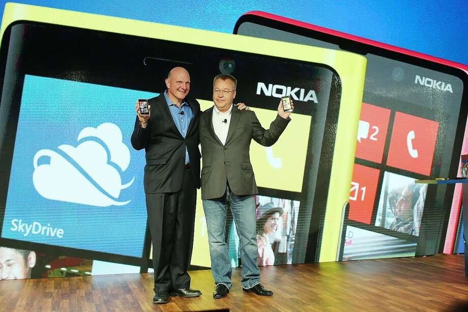 FILE - SEPTEMBER 3, 2013: It was reported that Microsoft has reached a deal with Nokia to buy the handset and services business of Nokia for more than $7.1 billion September 3, 2013 NEW YORK, NY - SEPTEMBER 05:    Nokia Chief Executive Stephen Elop (R) stands with Steve Ballmer, Chief Executive Officer of Microsoft, during the introduction of  the new Nokia Lumia 920 and 820 Windows smartphones on September 5, 2012 in New York City. The new Nokia phones are the first smartphones built for Windows 8. Analysts see the new phones as Nokia's last chance to compete with fellow technology companies Apple and Samsung in the lucrative smartphone market.  (Photo by Spencer Platt/Getty Images) Photo: Spencer Platt, Getty Images