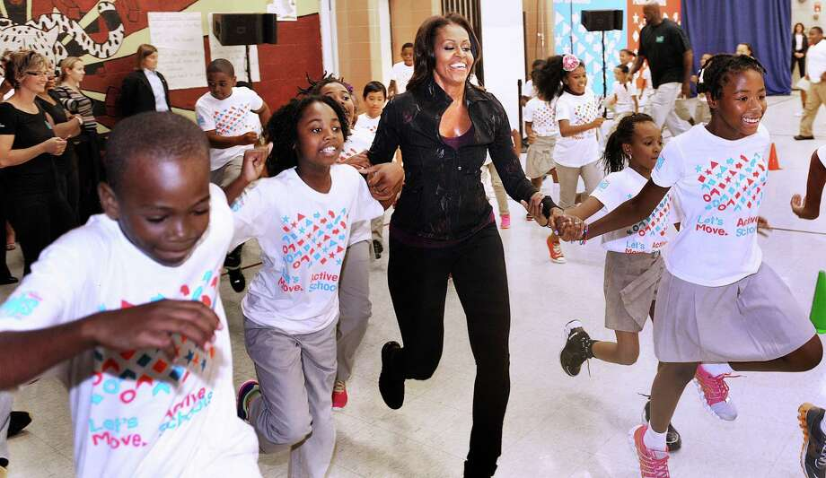 A White House summit on healthy eating is part of first lady Michelle Obama's Let's Move! initiative. Here she participates in a physical activity with children during a visit to Orr Elementary School in Washington, D.C. Photo: McClatchy-Tribune News Service