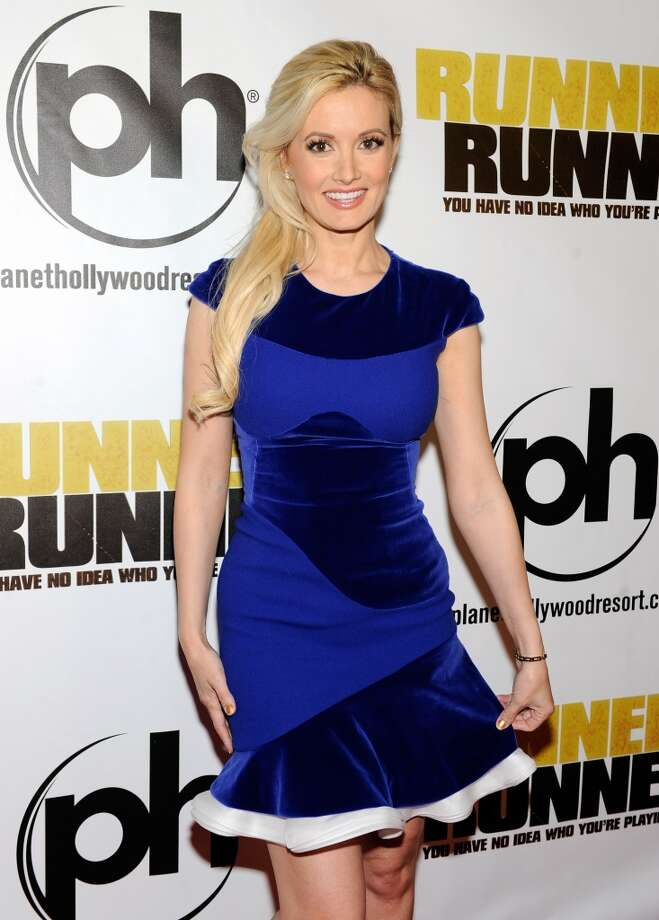 "Model and television personality Holly Madison arrives at the world premiere of Twentieth Century Fox and New Regency's film ""Runner Runner"" at Planet Hollywood Resort & Casino on September 18, 2013 in Las Vegas, Nevada.  (Photo by David Becker/Getty Images) Photo: David Becker, Getty Images"
