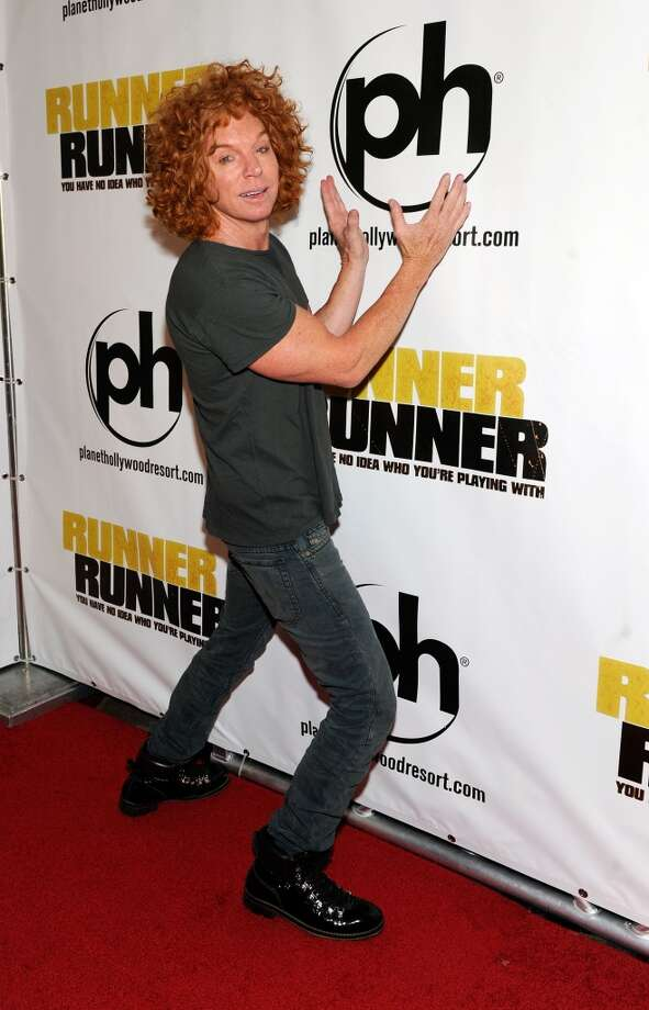 "Comedian Carrot Top arrives at the world premiere of Twentieth Century Fox and New Regency's film ""Runner Runner"" at Planet Hollywood Resort & Casino on September 18, 2013 in Las Vegas, Nevada.  (Photo by David Becker/Getty Images) Photo: David Becker, Getty Images"