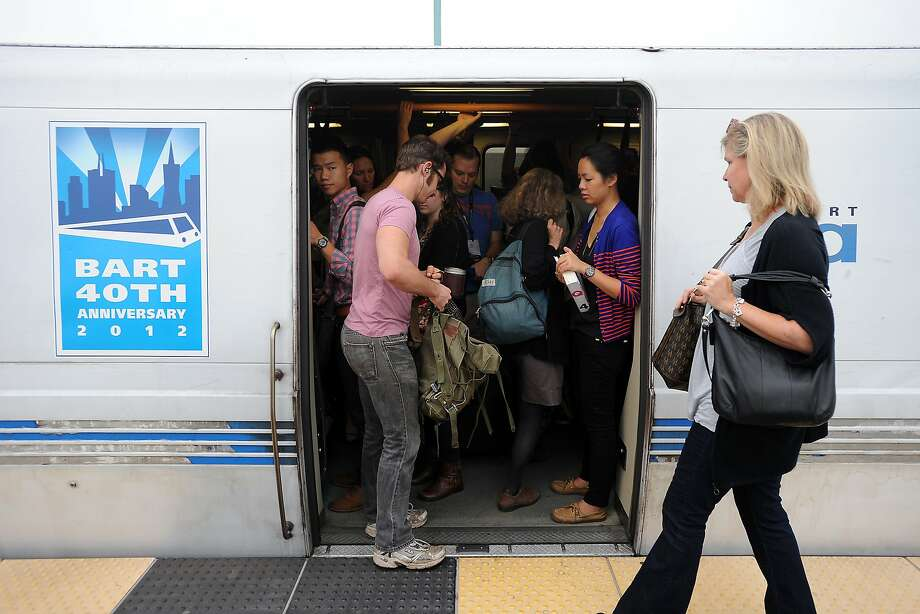 In this file photo, passengers board a crowded San Francisco bound train during the morning commute. An equipment problem near San Bruno was causing delays of up to 15 minutes for BART trains Friday morning. Photo: Michael Short, Special To The Chronicle