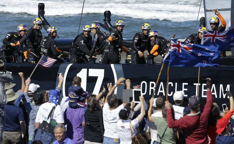 Oracle Team USA sails past spectators after the 13th race of the America's Cup sailing event against Emirates Team New Zealand was canceled due to excessive wind on Thursday, Sept. 19, 2013, in San Francisco. Photo: Ben Margot, Associated Press
