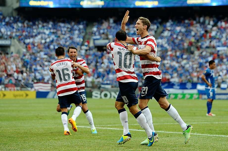 Clarence Goodson (right) gets a pat on the back from Landon Donovan in July. Photo: Patrick McDermott, Getty Images