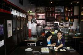 Lily Fang, left, and Kathy Fang, right, make dumplings at their restaurant House of Nanking in Chinatown in San Francisco, Calif. on August 15, 2013.