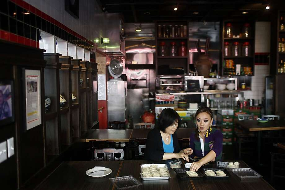 Mother and daughter Lily (left) and Kathy Fang make dumplings at their restaurant House of Nanking in Chinatown. About once a month, the Fangs gather to make and store a stash of dumplings. Photo: Ian C. Bates, The Chronicle