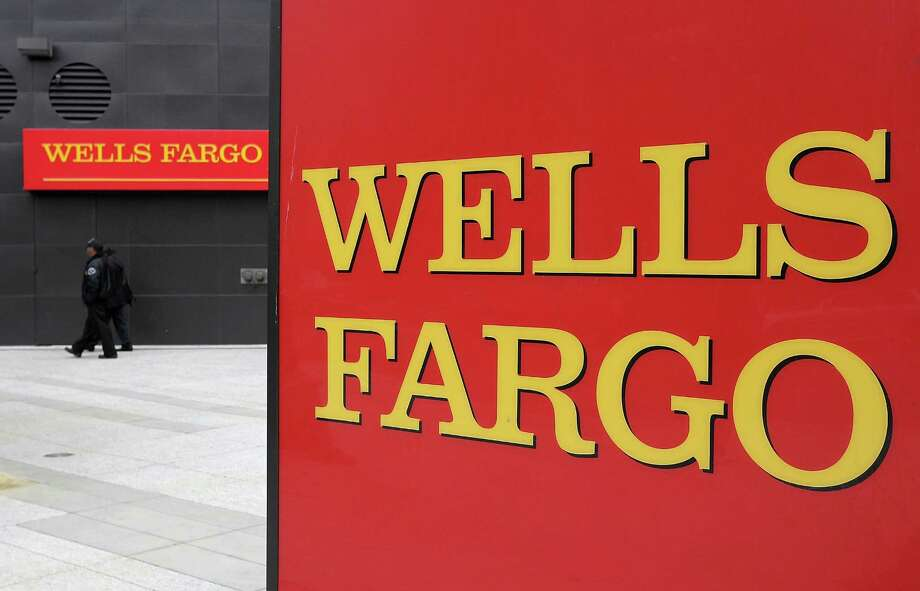 FILE - SEPTEMBER 18, 2013: According to reports, the largest U.S. mortgage lender Wells Fargo is to cut 1,800 jobs from its home loan business. OAKLAND, CA - JULY 19:  A sign is posted in front of a Wells Fargo Bank branch on July 19, 2011 in Oakland, California.  San Francisco-based Wells Fargo & Co. reported a 30 percent surge in quarterly profits with earnings of $3.73 billion, or 70 cents per share compared to $2.88 billion, or 55 cents per share one year ago.  (Photo by Justin Sullivan/Getty Images) ORG XMIT: 119520239 Photo: Justin Sullivan / 2011 Getty Images