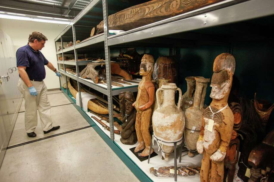 Dirk Van Tuerenhout, PhD, curator of anthropology, shows off items stored at the Museum of Natural Science's Marconi street warehouse, which will allow visitors, for a price, to tour same, Sept. 19, 2013 in Houston. Photo: Eric Kayne, For The Chronicle / ©Eric Kayne 2013