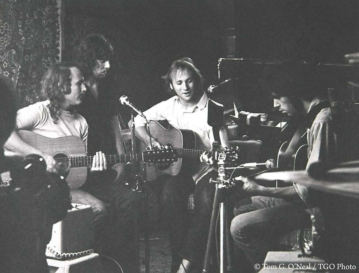 """CSNY -- David Crosby (far left), Stephen Stills (center right), Graham Nash (center left) and Neil Young (far right) -- rehearse in Studio City in 1969 for Woodstock. """"They renovated Peter Tork's garage by hanging oriental rugs up on the walls for sound,""""recalled photographer Tom O'Neal."""
