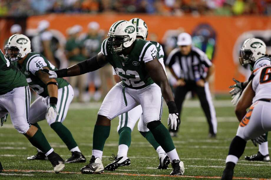 New York Jets offensive tackle Vladimir Ducasse (62) in action against the Cincinnati Bengals in an NFL preseason football game, Friday, Aug. 10, 2012, in Cincinnati. (AP Photo/David Kohl) Photo: David Kohl, Associated Press / Associated Press