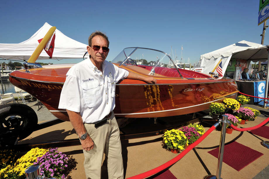 Ralph Maresco shows off his 1958 19-foot Chris-Craft Capri wooden boat during the Norwalk Boat Show at the Norwalk Cove Marina in Norwalk, Conn., on Thursday, Sept. 19, 2013. The boat show will continue every day this week until Sunday with hours from 10 a.m.-6 p.m. Photo: Jason Rearick / Stamford Advocate