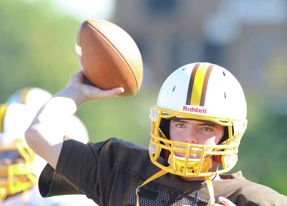 Brunswick School quarterback Billy O'Malley throws during football practice at the school in Greenwich, Thursday, Sept. 19, 2013. Photo: Bob Luckey / Greenwich Time