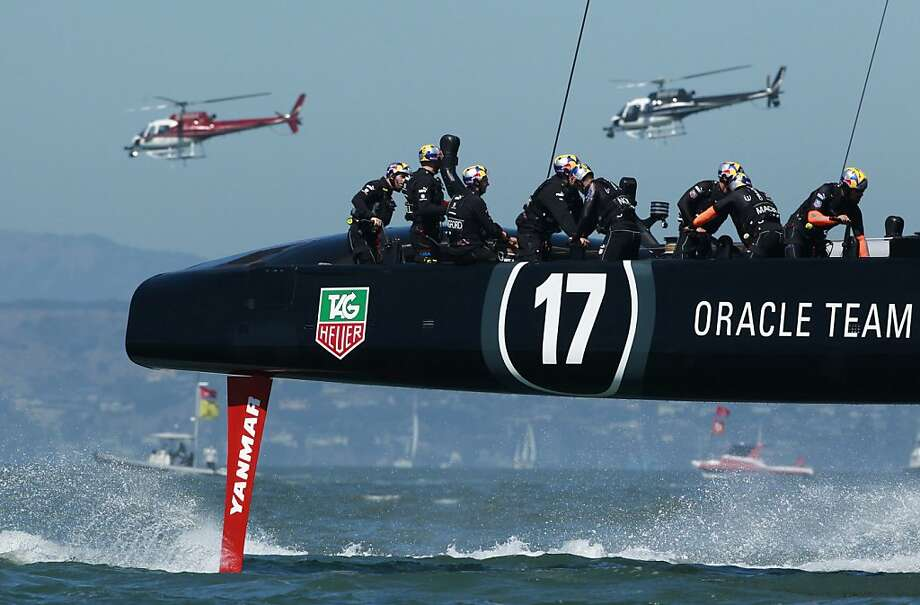 The Oracle Team USA crew gets in prerace practice on the bay before its victory over Team New Zealand. Photo: Beck Diefenbach, Special To The Chronicle