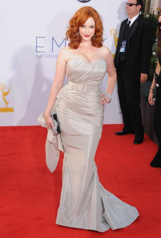 "Hit: Christina Hendricks, 2012. The ""Mad Men"" star is another woman who knows how to flaunt those curves, and her hair looks beautiful. Though we are on the fence about the belt. Photo: Jon Kopaloff, FilmMagic"