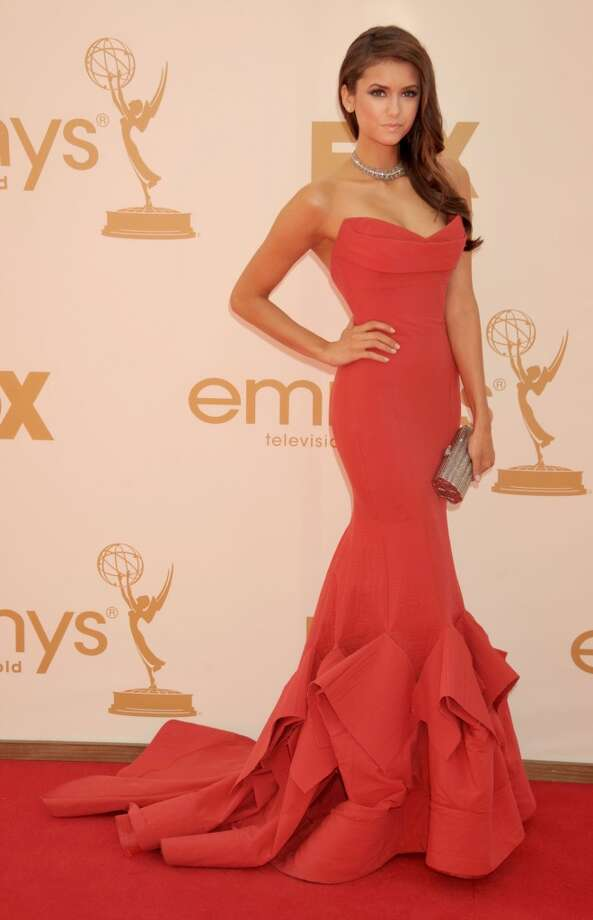 """Hit:Nina Dobrev, 2011. """"The Vampire Diaries"""" star established herself as a fashionista with this gorgeous, fitted Donna Karan dress. Photo: Gregg DeGuire, FilmMagic"""