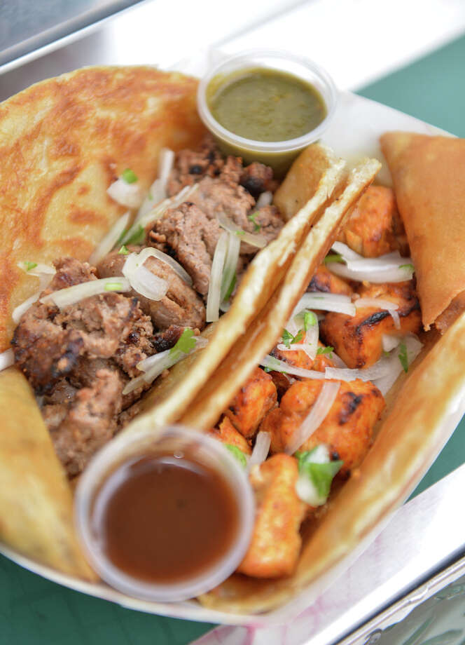 A Tony from the Rickshaw Stop food truck is two flatbreads with meat kebabs (beef and chicken shown) and Samosas. Photo: For The San Antonio Express-News