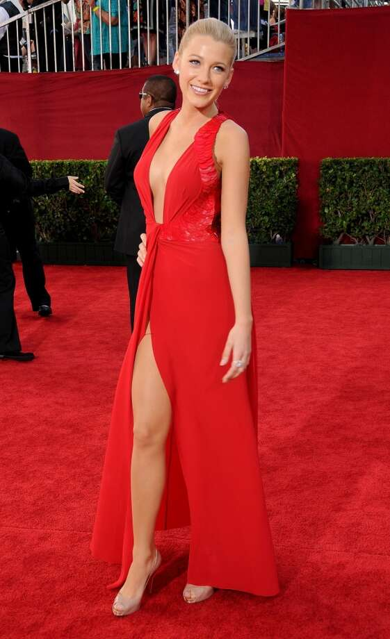 "Hit: Blake Lively, 2009. The ""Gossip Girl"" star nails it with this low- and high-cut red Versace gown. Photo: Gregg DeGuire, FilmMagic"
