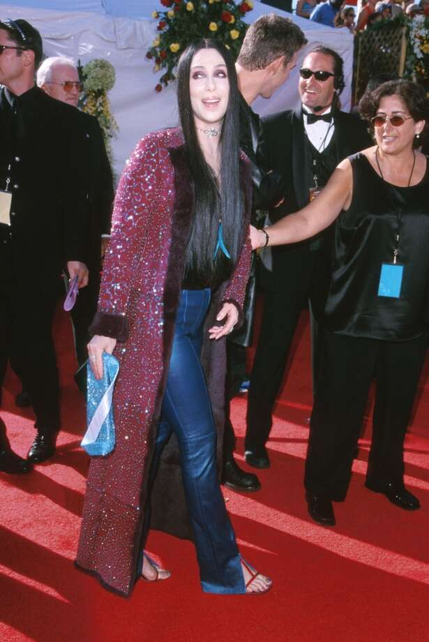 """Miss:Cher, 2000. Sure, Cher has been known to break out some, um, """"interesting"""" red carpet ensembles through the years, but these jeans, flip flops and sparkly bathrobe are just boring. Photo: SGranitz, WireImage"""