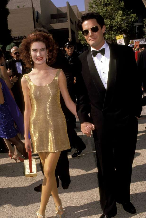 Miss: Lara Flynn Boyle, 1991. The gold dress looks cheap, but it's the tights that really send us over the edge. Photo: Jim Smeal, WireImage