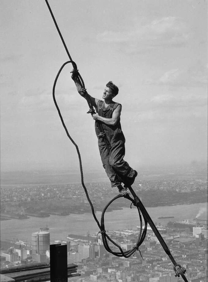 "Lewis Hine's ""Icarus Atop Empire State Building"" is one of many breathtaking images on view in a new exhibit at Fairfield University. Photo: Contributed Photo / Connecticut Post Contributed"