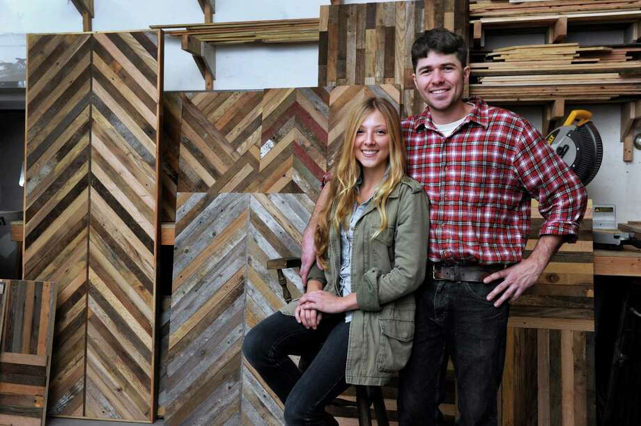 Sarah Bader, 27, and her husband Matt Rink, 29, of Redding, Conn., owners of New Antiquity, in Bethel, Conn., are photographed in their workshop Thursday, Sept. 19, 2013. The different patterns and designs behind them are a sample of the table tops that the furniture designing duo offer their custumers. Photo: Carol Kaliff / The News-Times