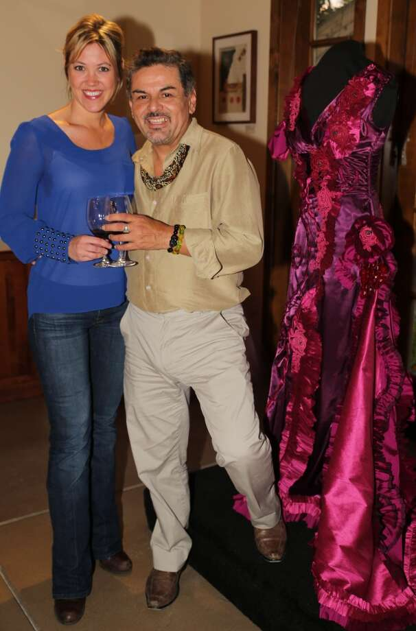 "Designer Rory Castillo shares a toast with Tracy McArdle of Jessup Cellars next to his ""California Wine Country"" inspired gown. Photo: William Bucquoy, Jessup Cellars"