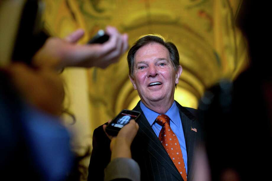 "Former House Majority Leader Tom DeLay tells reporters in Washington, D.C., that his acquittal Thursday was a ""happy day."" Photo: Carolyn Kaster, STF / AP"