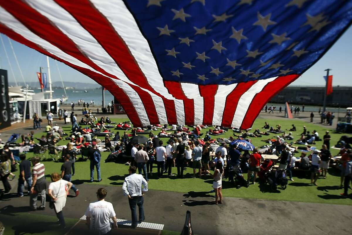 Fans gather to watch the days racing during the America's Cup Finals in San Francisco, California Thursday, September 19, 2013.