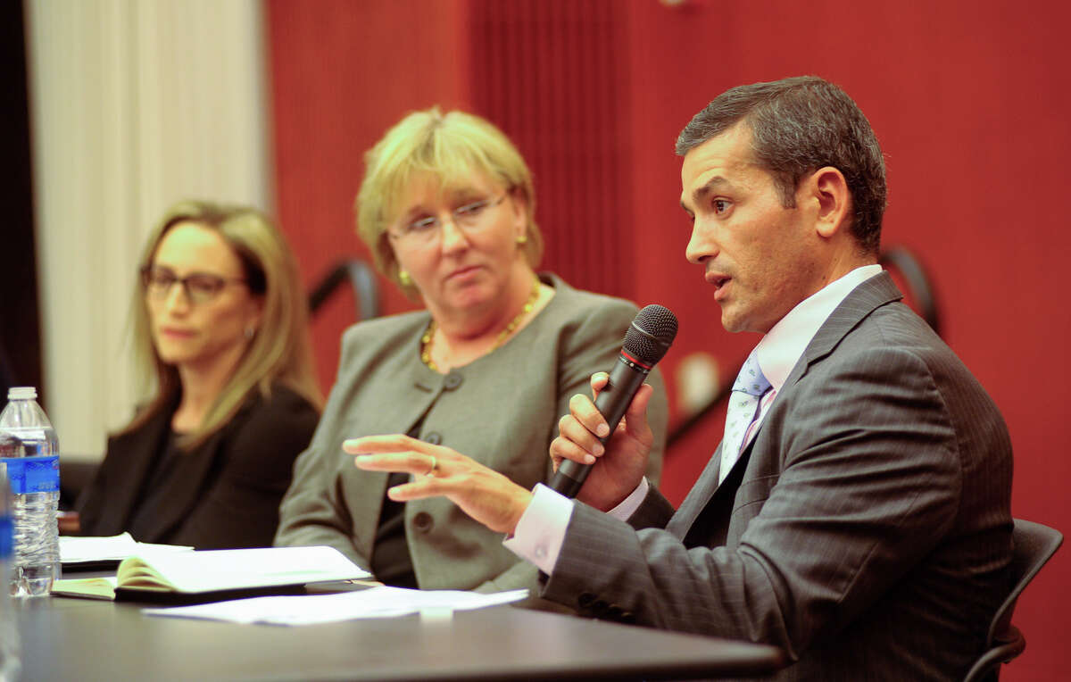 State Representative Mike Villareal speaks during a panel discussion at Trinity University Thursday on standardized testing and House Bill 5 that reduced testing for students.Listening are Laura Yeager (left) of Texans Advocating For Meaningful Student Assessment and Shari Albright, Trinity University Department of Eduction Chair.