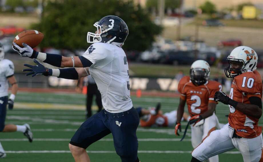 Receiver Tyler Coiner of Smithson Valley hauls in a first-quarter touchdown pass during high school football action against Madison at Comalander Stadium on Thursday, Sept. 19, 2013. Photo: Billy Calzada, San Antonio Express-News / San Antonio Express-News