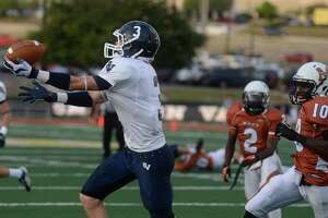 Receiver Tyler Coiner of Smithson Valley hauls in a first-quarter touchdown pass during high school football action against Madison at Comalander Stadium on Thursday, Sept. 19, 2013.