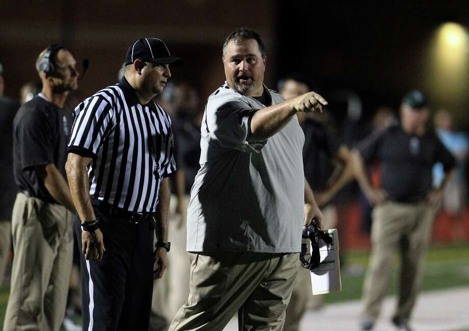 Kingwood Park's head coach Jim Holley talks to a referee during the fourth quarter of the Porter-Kingwood Park High School football game at Turner Stadium, Thursday, Sept. 19, 2013, in Humble. Photo: Karen Warren, Houston Chronicle / © 2013 Houston Chronicle